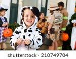 halloween  smiling boy in...   Shutterstock . vector #210749704