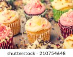 colorful cupcakes frosted with... | Shutterstock . vector #210754648