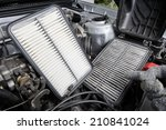 Small photo of comparison between new and used air filter for car, automotive spare part