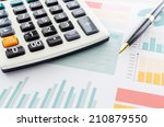 graphs and calculator | Shutterstock . vector #210879550