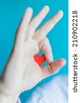 small paper heart in arm | Shutterstock . vector #210902218