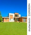 luxury house against blue sky... | Shutterstock . vector #210909094