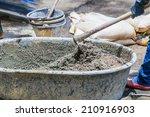 construction workers cement    Shutterstock . vector #210916903