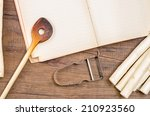 wooden spoon  book  peeler and... | Shutterstock . vector #210923560