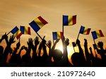 group of people waving romanian ... | Shutterstock . vector #210972640