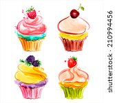 cupcakes with cream and berries.... | Shutterstock .eps vector #210994456