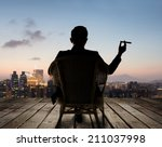 silhouette of businessman sit... | Shutterstock . vector #211037998