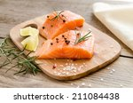 Raw Salmon Steaks On The Woode...