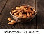 almonds in basket on brown...   Shutterstock . vector #211085194