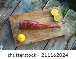 Raw Fish On A Wooden Backgroun...
