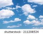 Fluffy Clouds On The Blue Sky
