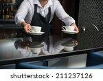 barista wearing white shirt and ... | Shutterstock . vector #211237126