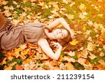autumn woman. beautiful young... | Shutterstock . vector #211239154