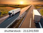 Two Trucks On Highway In Motio...