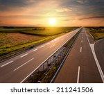 open highway at sunset  near... | Shutterstock . vector #211241506