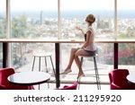 young slim beautiful girl sits... | Shutterstock . vector #211295920