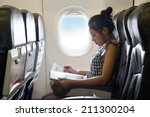 young woman travels in a chair... | Shutterstock . vector #211300204