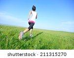 runner athlete running on grass ... | Shutterstock . vector #211315270