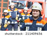 Firefighter In Uniform In Front ...