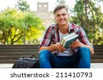 happy bookworm. handsome male... | Shutterstock . vector #211410793