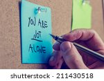 you are not alone   man writing ... | Shutterstock . vector #211430518