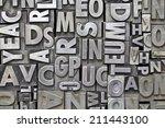 vintage metal letterpress type | Shutterstock . vector #211443100