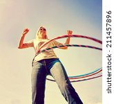 a woman hula hooping on a clear ... | Shutterstock . vector #211457896