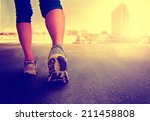 a woman with an athletic pair... | Shutterstock . vector #211458808