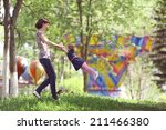 little girl playing with mom | Shutterstock . vector #211466380