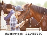 Woman Hugging Horse And...