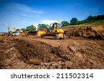 Small photo of industrial machinery at working construction building site. Excavator, dumper truck and bulldozer working on ground