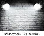 dark background with spotlights    Shutterstock . vector #211504003