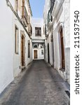 A typical Andalusian street with whitewashed houses. Nijar, a village in the province of Almeria (Spain). - stock photo