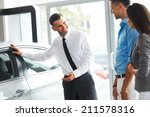 car sales consultant showing a... | Shutterstock . vector #211578316