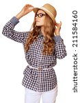 Small photo of young pretty woman with retro garb holding her hat against white background