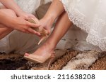 bride dressing gown | Shutterstock . vector #211638208
