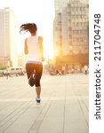 runner athlete running on city... | Shutterstock . vector #211704748