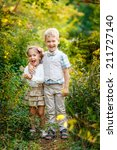 boy with his sister in the park | Shutterstock . vector #211727140