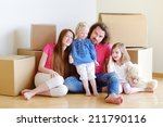 happy young family sitting on a ... | Shutterstock . vector #211790116
