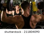 fit men training his bicep at... | Shutterstock . vector #211804090