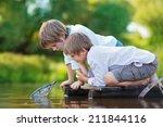 two cute little boys sitting on ... | Shutterstock . vector #211844116
