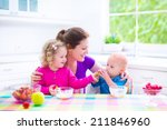 happy young family  mother with ... | Shutterstock . vector #211846960