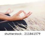 woman meditating practicing... | Shutterstock . vector #211861579