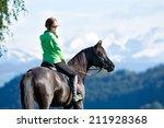 Stock photo woman riding horse 211928368
