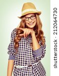 Small photo of portrait of a cute young woman with casual garb pointing to the