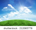 Green Hill Under Blue Sky With...