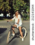 young woman on a retro bicycle | Shutterstock . vector #212141044