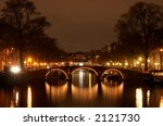 Stock photo canals in amsterdam at night photo taken with a long exposure 2121730