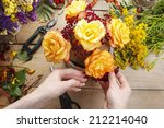 florist at work  woman making... | Shutterstock . vector #212214040
