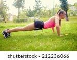 blonde athletic muscular woman...   Shutterstock . vector #212236066
